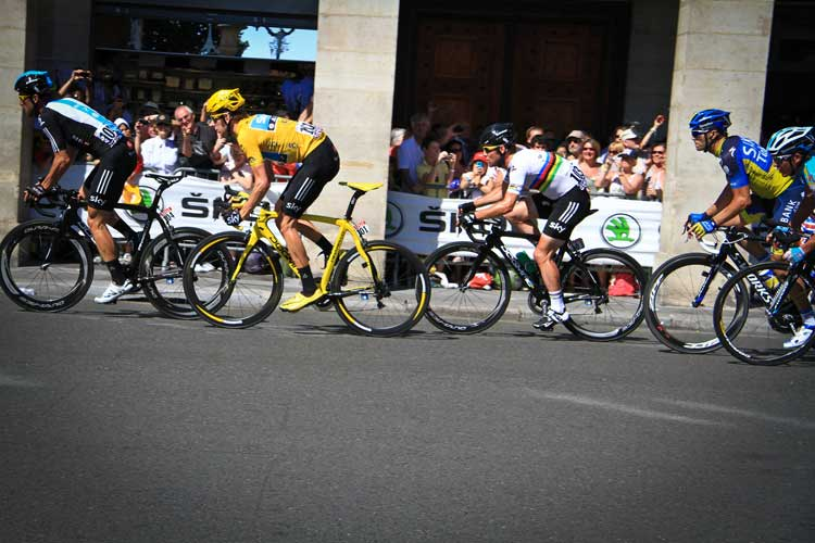Bradley Wiggins gets set to lead Mark Cavendish on to the Champs-Élysées during the 2012 Tour de France