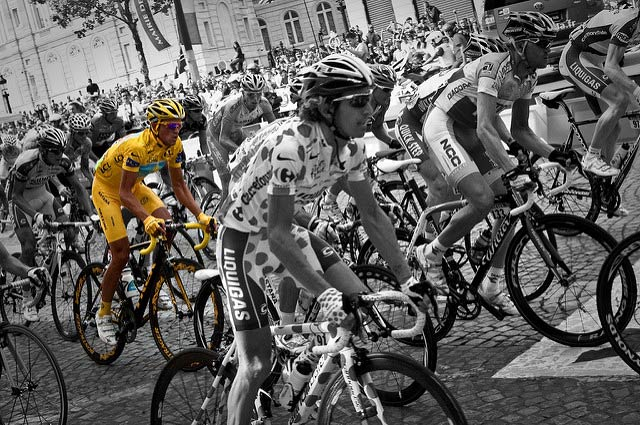 The yellow jersey of eventual winner Alberto Contador stands out from the crowd as the 2009 Tour de France arrives in Paris. Photo: Josh Hallett