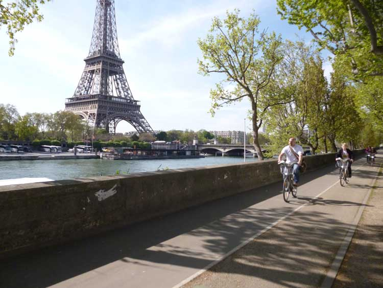 Riding your bike along the River Seine in Paris