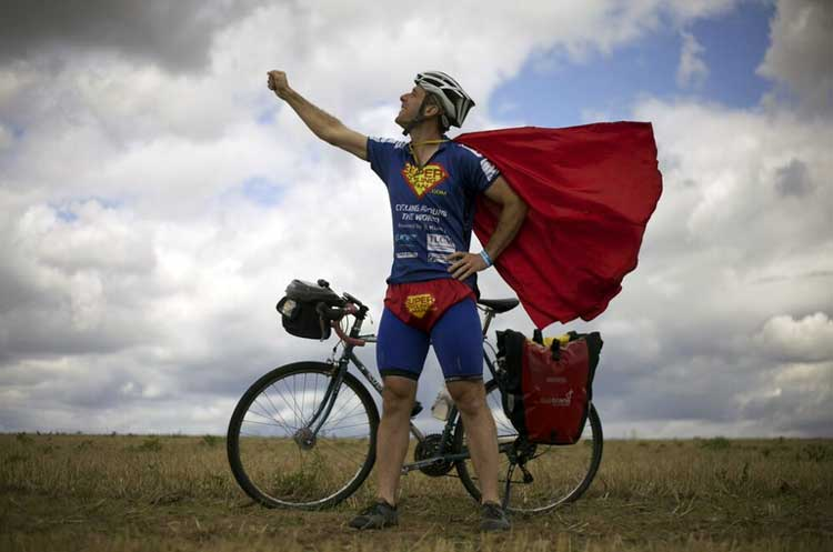 The man cycling the world dressed as Superman ...